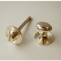 Oval Knob Turn and Release on Reeded Rose - Polished Brass